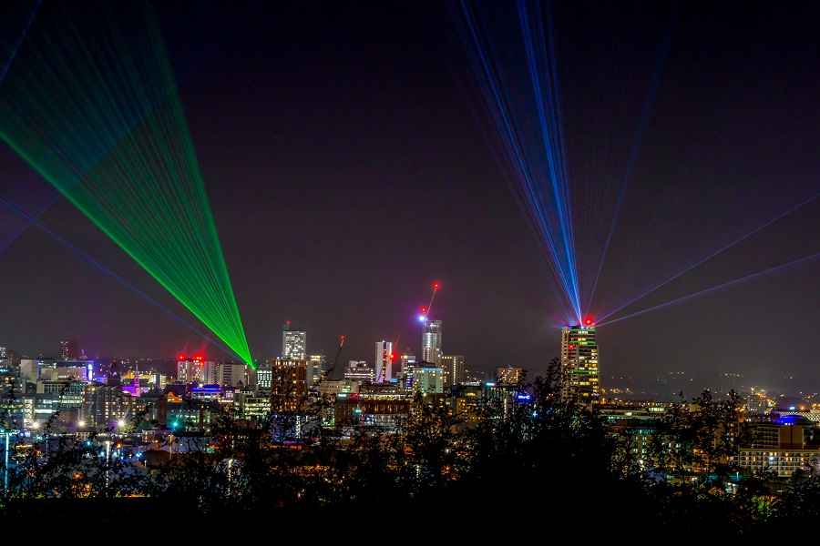 Laser Light City - multicoloured lasers in the skyline at night